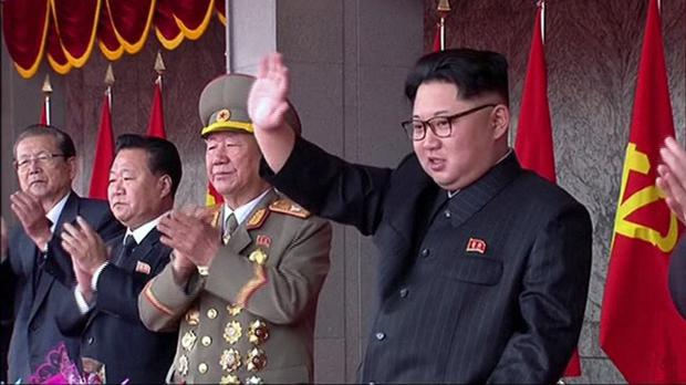 Kim Jong Un waves as people parade to celebrate the first congress of the ruling Workers' Party in 36 years (KRT/AP)