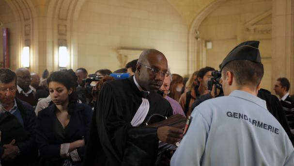 French lawyer Richard Gisagara, defending Constance Mukabazayire from Rwanda, enters the court in Paris (AP)