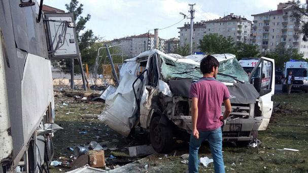 The explosion site after a car bomb struck a bus carrying Turkish police officers in the mainly-Kurdish city of Diyarbakir (AP)