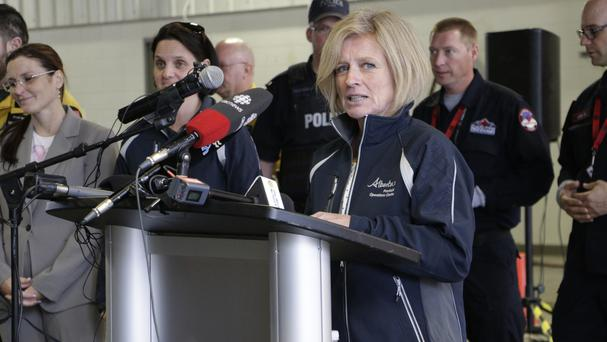 Rachel Notley said the massive oil sands mines north of Fort McMurray have not been damaged (Rachel La Corte/Canadian Press/AP)