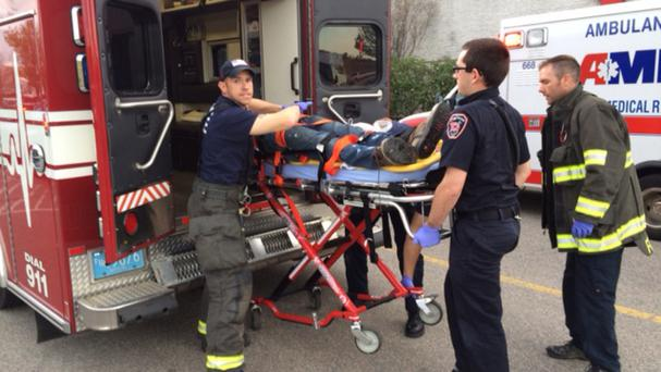 Medical workers treat an injured man at Silver City Galleria (Charles Winokoor/Daily Gazette/AP)