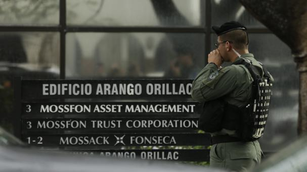 A police officer outside the Mossack Fonseca law firm in Panama City (AP)