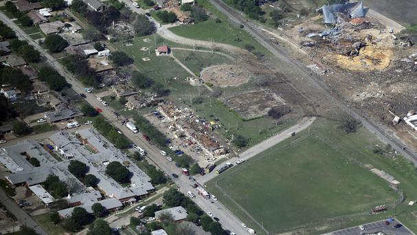 The remains of a nursing home, apartment complex and fertilizer plant destroyed by the explosion in West, Texas. (AP Photo/Tony Gutierrez, File)