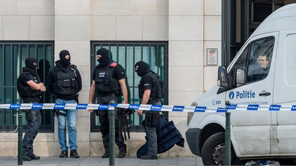 Police stand guard as terror suspect Mohamed Abrini's case is discussed in court at a justice building in Brussels. File picture