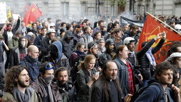 Demonstrators march during a protest against labour reforms in Paris (AP)