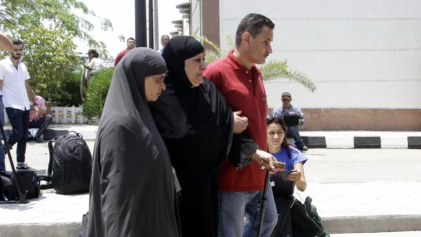 Relatives of passengers at Cairo International Airport (AP)