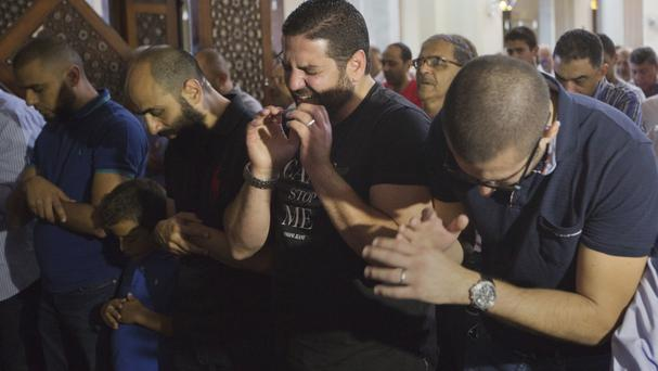 Families of victims of the EgyptAir plane crash attend prayers for the dead in Cairo (AP)