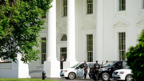 Secret Service agents stand near the North Lawn of the White House after the building was placed in lock-down following a shooting nearby (AP)