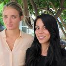 Courtney Wilson, left, and Taylor Guerrero said they were arrested for kissing in a grocery store (AP)