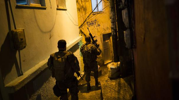 Officers enter an alley during the Rocinha slum battle between police and drug gangs (AP)