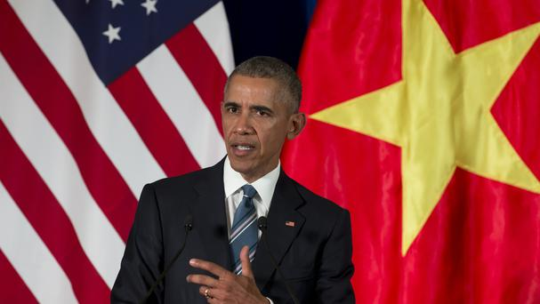 US President Barack Obama speaks during a news conference with Vietnamese President Tran Dai Quang in Hanoi (AP)