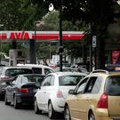 Drivers line up as they wait to buy fuel at a Paris petrol station (AP)