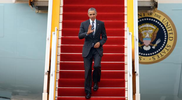 Barack Obama arrives on Air Force One at Tan Son Nhat International Airport in Ho Chi Minh City, Vietnam (AP)