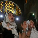 Relatives of the Christian victims of the crashed EgyptAir flight MS804 attend an absentee funeral mass at the main Cathedral in Cairo, Egypt
