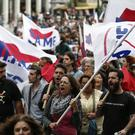 Supporters of the communist-affiliated union PAME chant slogans during an anti-austerity rally in Athens (AP)