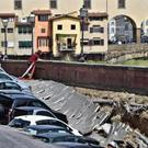 Cars engulfed by a chasm which opened along Florence's Arno river near the Ponte Vecchio (Old Bridge) (Ansa/AP)