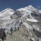 International trekkers pass through a glacier at the Mount Everest base camp (AP)