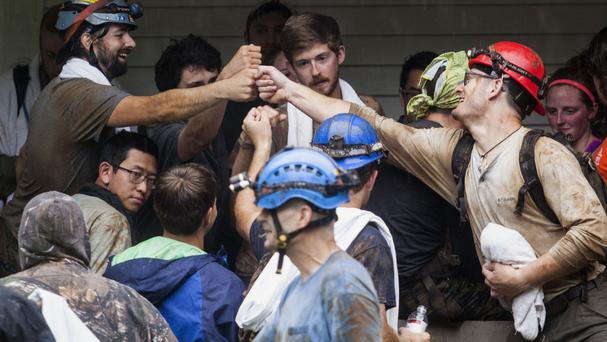 People who escaped from Hidden River Cave celebrate (/Daily News/AP)