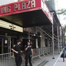 Police officers outside Irving Plaza, following the shooting at the venue where hip-hop artist T.I. was getting ready to perform. (AP)