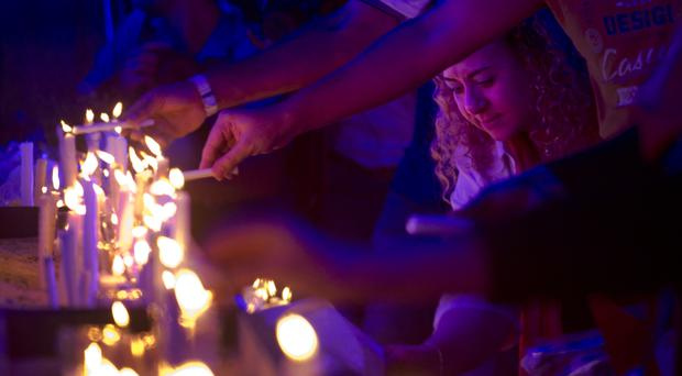 Egyptians light candles during a vigil for the victims of EgyptAir flight 804 in Cairo (AP)
