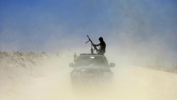 Militants from the Islamic State group have seized a string of villages from Syrian rebels near the Turkish border (AP)