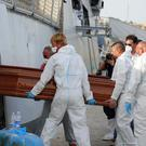 The Italian navy said it had saved 135 migrants and recovered 45 bodies (AP)