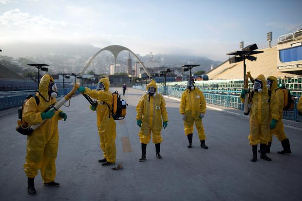 Brazilian health workers spray insecticide to combat Zika mosquitoes in Rio de Janeiro Photo: AP