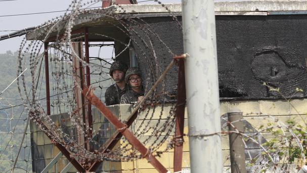 South Korean soldiers at a military checkpoint near the border village of Panmunjom (AP)