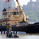 NYPD search and rescue boats on the Hudson River near where a wartime Thunderbolt aircraft crashed into the river (AP)