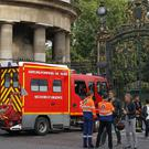 A fire engine is parked at the entrance to the Parc Monceau in Paris, where 11 people were hit by lightning (AP)