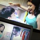 Two scenes from the controversial detergent advert by Shanghai Leishang Cosmetics Ltd shown on computer screens in Beijing (AP)