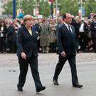 Angela Merkel and Francois Hollande arrive at a remembrance ceremony to mark the centenary of the battle of Verdun (AP)