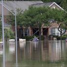 A flooded street in Spring, Texas, after the state was hit by heavy rain (AP)