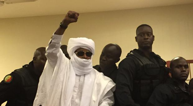 Chad's former dictator Hissene Habre raises his hand during court proceedings in Dakar, Senegal (AP)