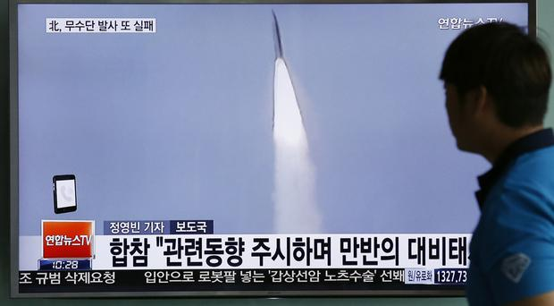 A South Korean TV news programme reports on the apparent failed North Korean missile launch (AP)