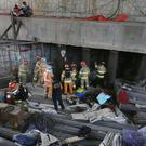 Rescue workers search for survivors after the explosion (Yonhap/AP)