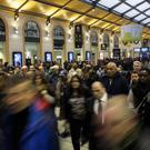 Commuters head to one of the few trains running after a strike starts at Gare Saint Lazare station in Paris (AP)