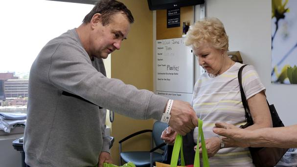 Thomas Manning and his mother Florence prepare to leave Massachusetts General Hospital (AP)