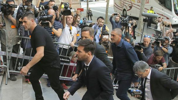 Lionel Messi arrives at court in Barcelona (AP)