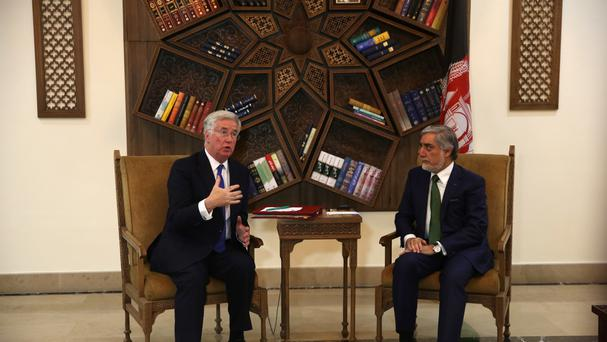 Michael Fallon, left, and Afghanistan's chief executive officer Abdullah Abdullah in Kabul (AP)