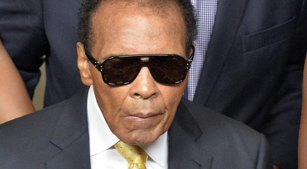 Muhammad Ali pictured in 2014 before the Ali Humanitarian Awards ceremony in Louisville, Kentucky (AP)