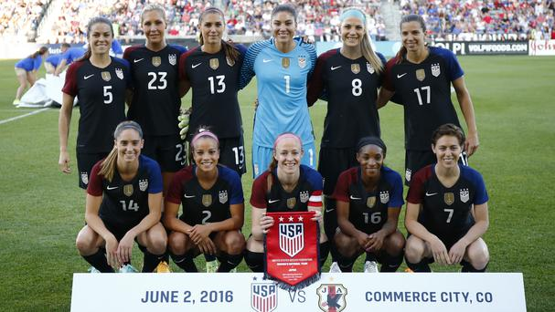 The US women's team poses before a friendly against Japan in Commerce City, Colorado (AP)