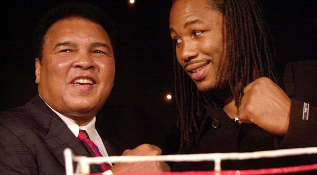 Lennox Lewis with boxing legend Muhammad Ali