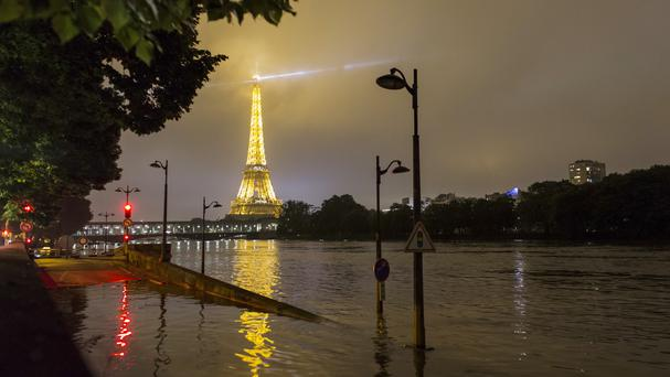 A traffic sign on the flooded banks of the Seine (AP)