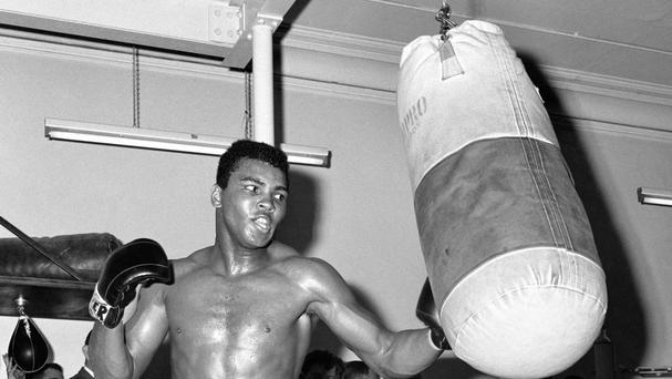Muhammad Ali pounds the punchbag