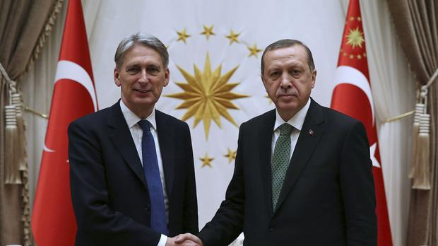Turkey's president Recep Tayyip Erdogan (right) is renowned for strong views on the role of women
