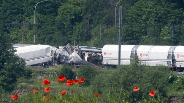 The wreckage of a passenger train and a freight train after they crashed in Hermalle-sous-Huy, near Liege, Belgium (AP)