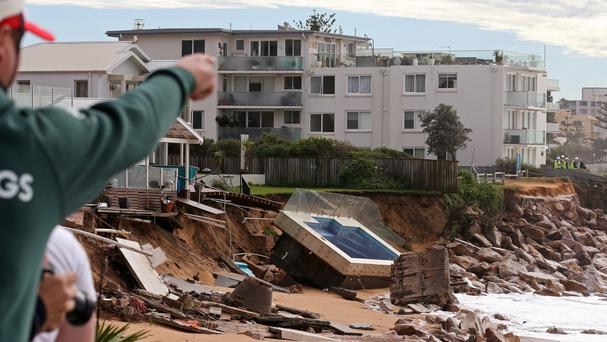 A swimming pool is dislodged and lays on a beach after storms undermined the pilings at Collaroy in Sydney (AP)