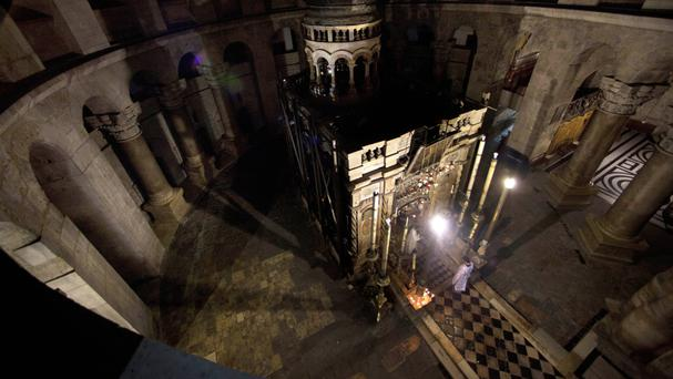 Greek Orthodox priests hold liturgy outside the tomb of Jesus in the Holy Sepulchre church in Jerusalem (AP)