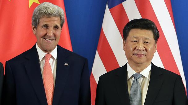 US Secretary of State John Kerry and China's President Xi Jinping during the joint opening ceremony of the 8th Strategic and Economic Dialogues (AP)